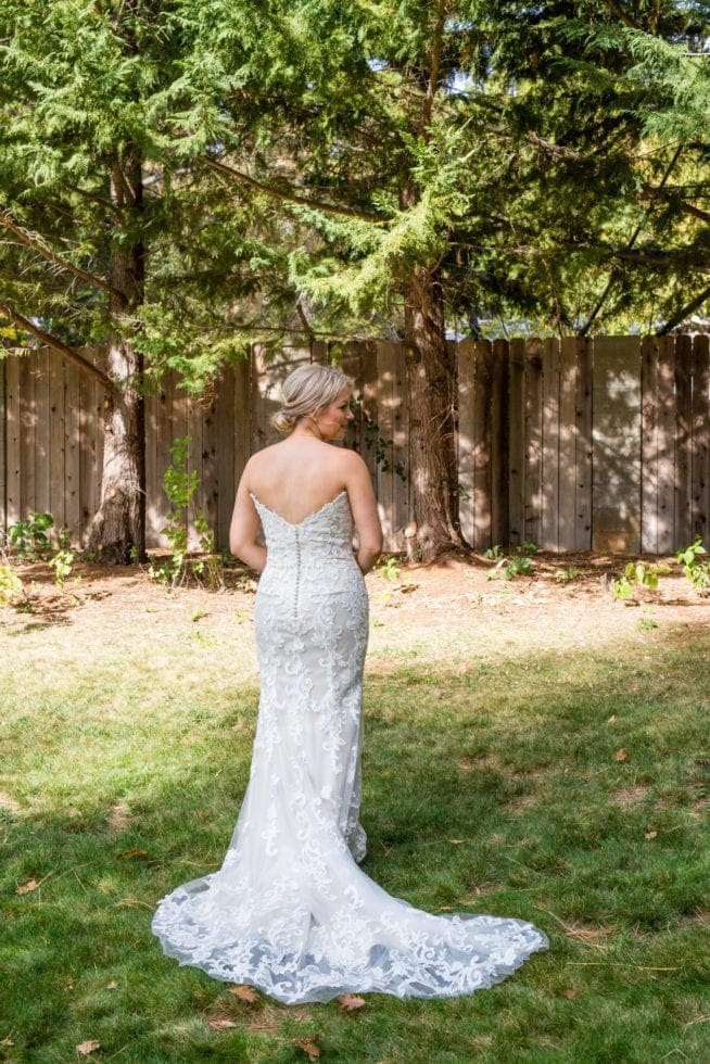 back of bride in wedding dress
