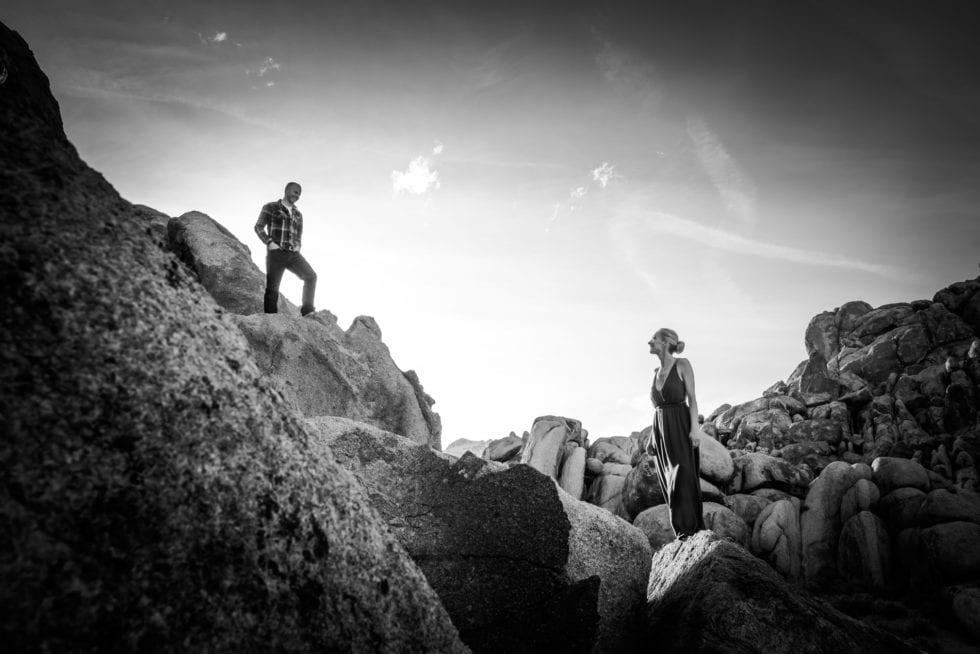 couple standing on top of rocks