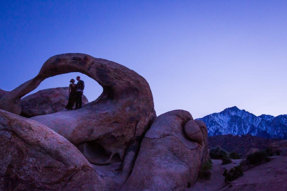 couple standing in round rock formation