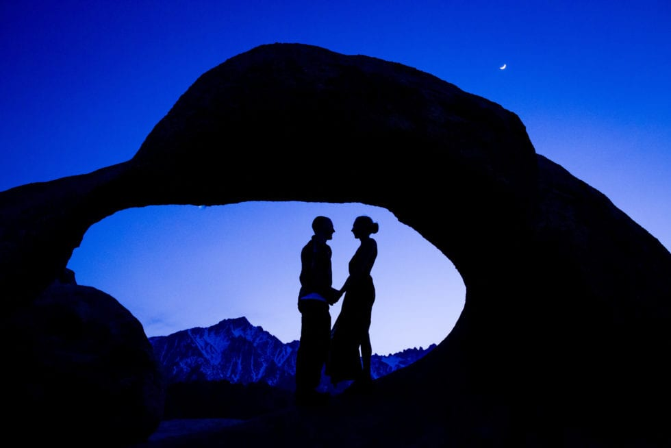 couple holding hands in round rock formation