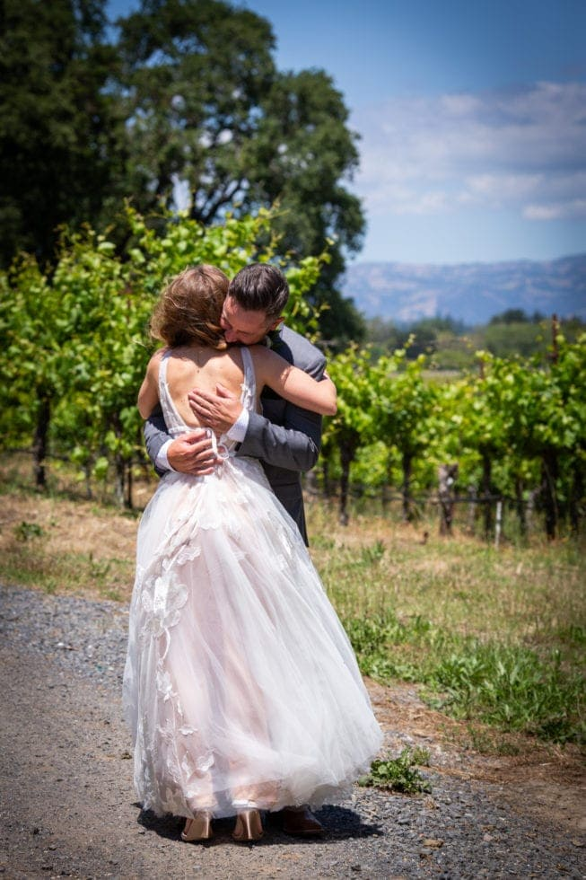 bride and groom embrace after first look at griffith woods