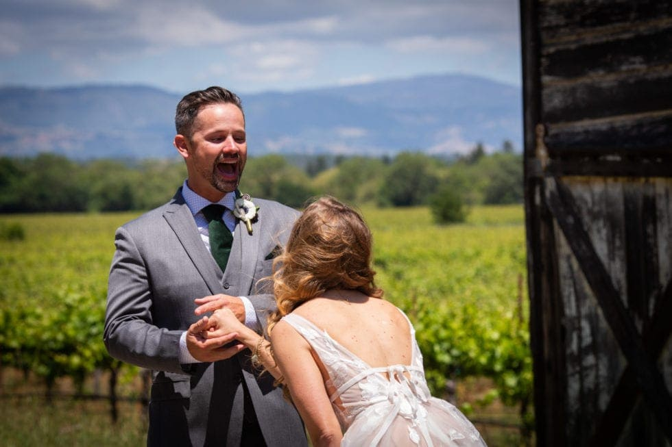 bride and groom laugh after first look at griffith woods
