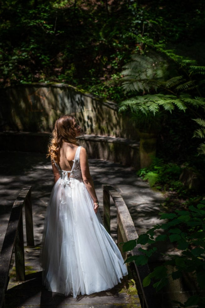 bride standing on bridge in griffith woods