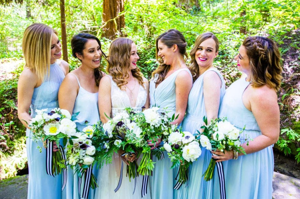 bridal party holding their bouquets at griffith woods
