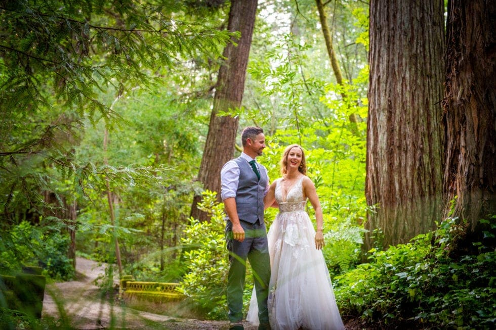 bride and groom smiling in griffith woods