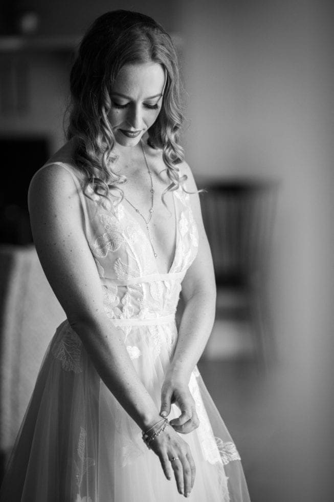 bride looking down and adjusting bracelet on her wrist