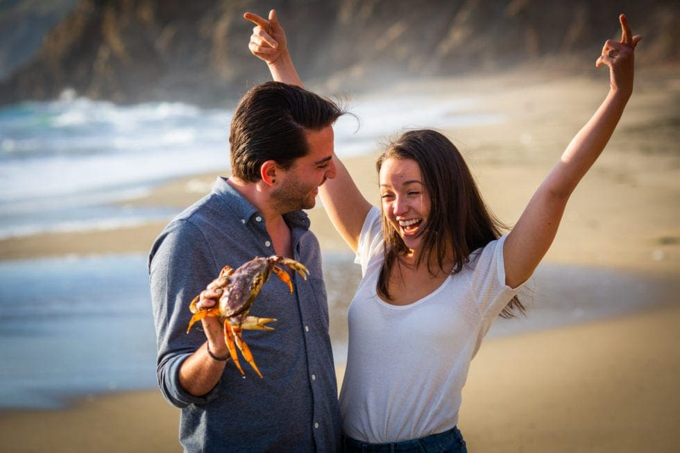 couple amused by crab