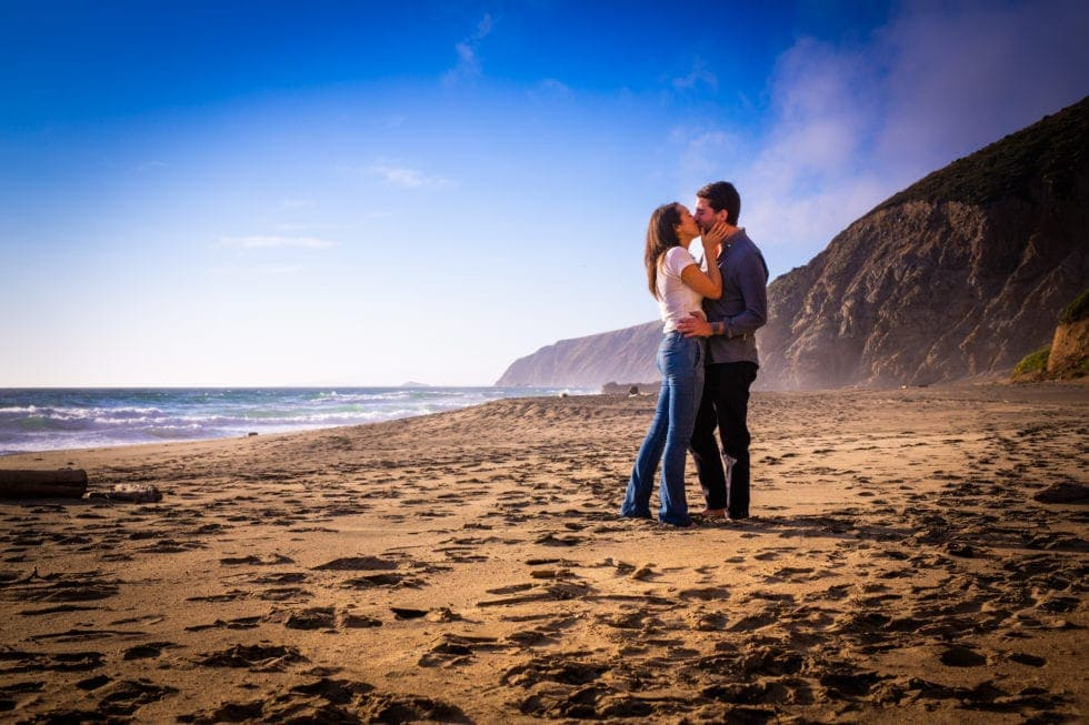 couple kissing at point reyes seashore