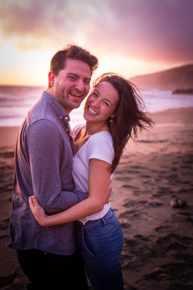 couple smiling during engagement session at point reyes seashore