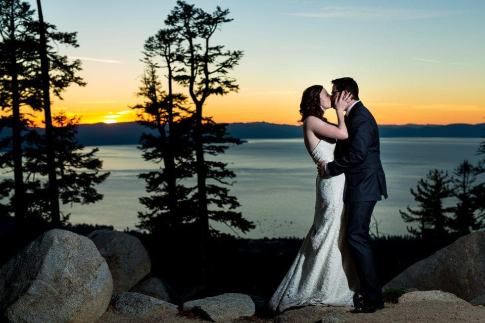 bride and groom kissing in front of sunset at heavenly mountain resort in south lake tahoe
