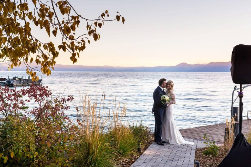 bride and groom kissing at the ritz carlton in truckee next to lake