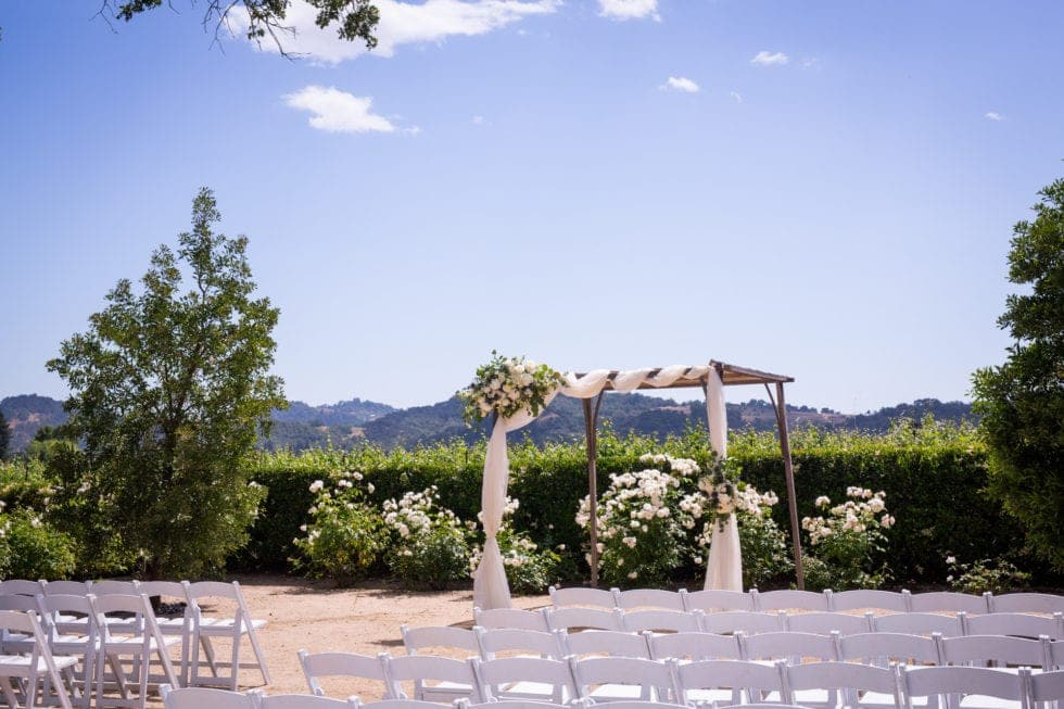arch and chairs at ceremony site at soda rock winery