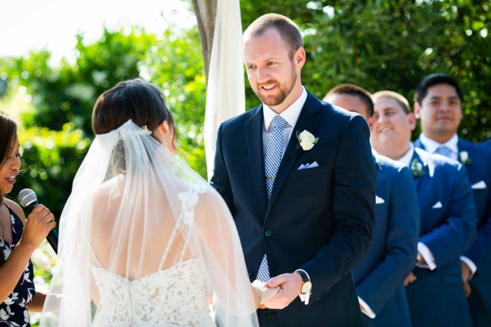 bride and groom exchange vows during ceremony at soda rock winery