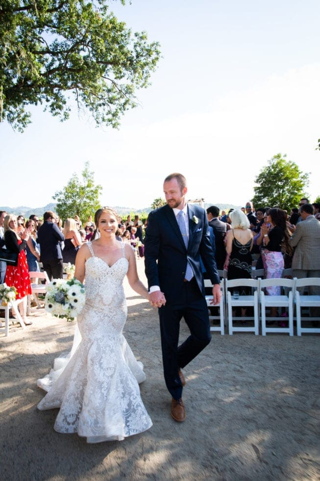 bride and groom walking back down aisle after ceremony at soda rock winery