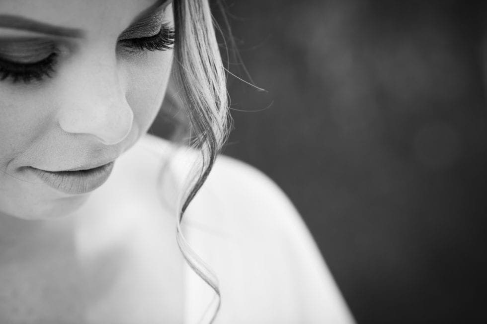 black and white photo of bride's makeup