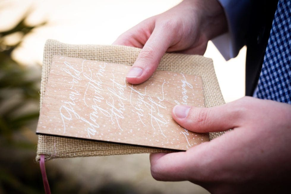 groom holding card from bride