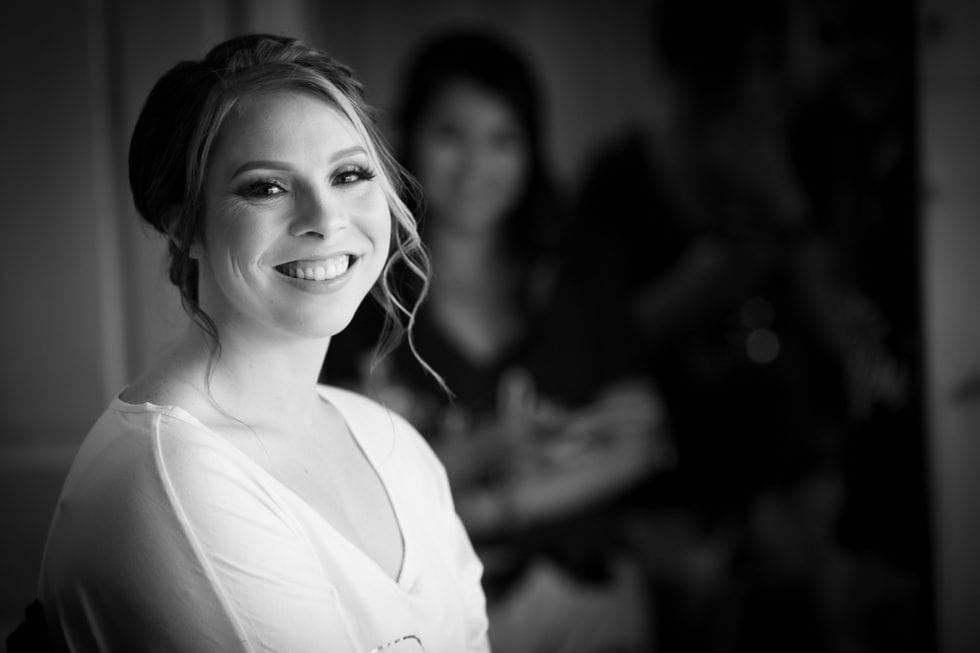 bride smiling while getting ready for wedding