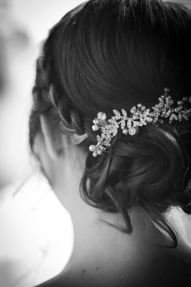 back of bride's hair with jeweled pin