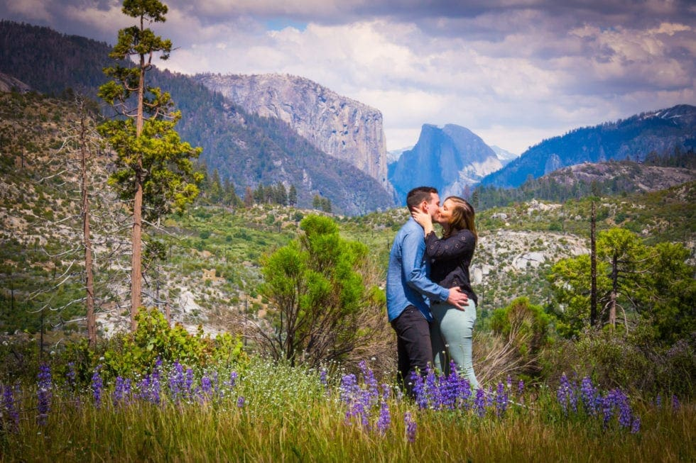 couple kissing in meadow during yosemite engagement session