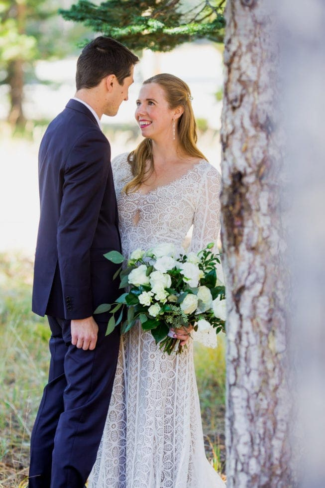 bride and groom looking at each other and smiling in bear valley ca