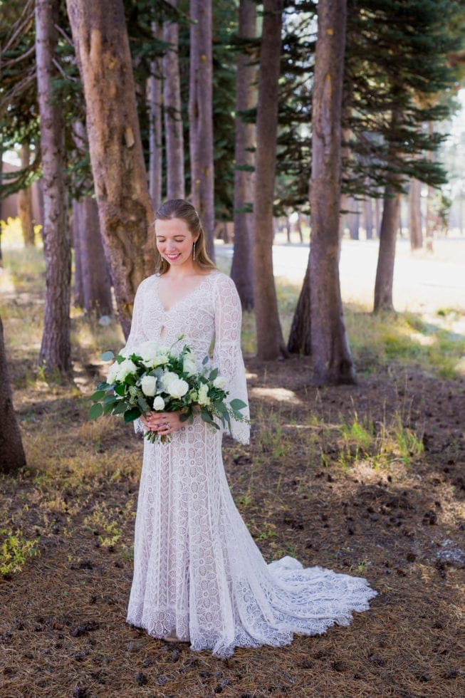 photo of bride in her dress with her bouquet