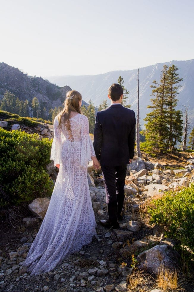 bride and groom overlooking view in bear valley ca