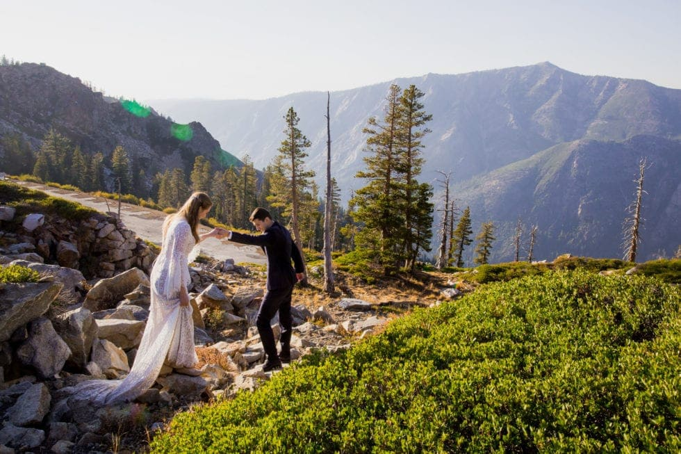 groom leading bride in front of bear valley ca