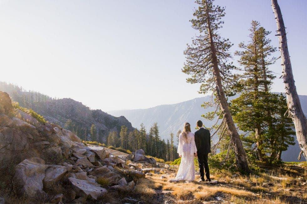 bride and groom overlooking bear valley