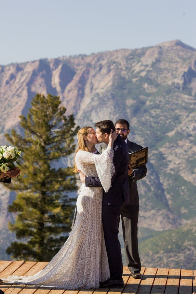 wedding photographer of first kiss overlooking bear valley