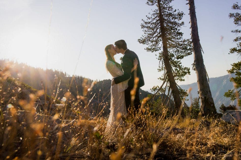 bride and groom kissing in bear valley