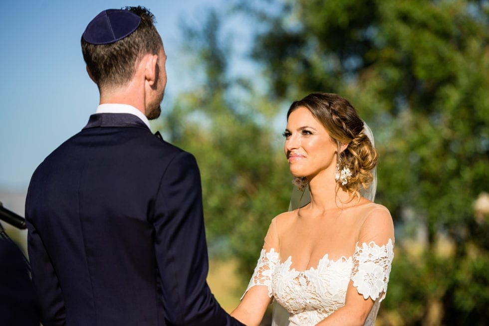 wedding photography of bride smiling at groom during ceremony at carneros resort