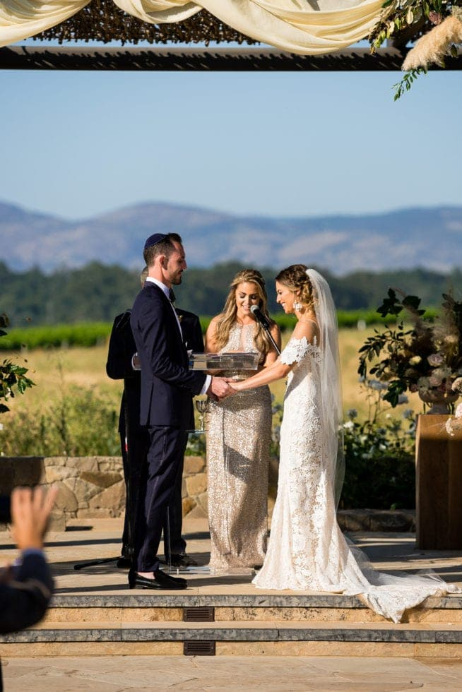 wedding photography of bride and groom during ceremony at carneros resort
