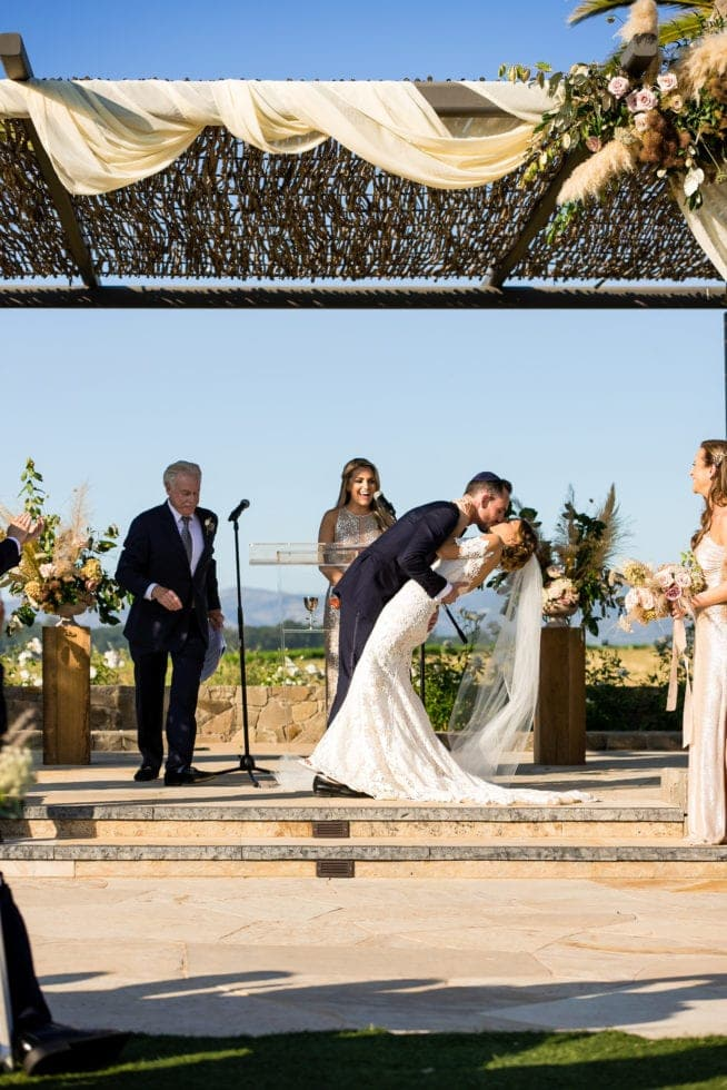 wedding photography of bride and groom's first kiss at carneros resort wedding ceremony