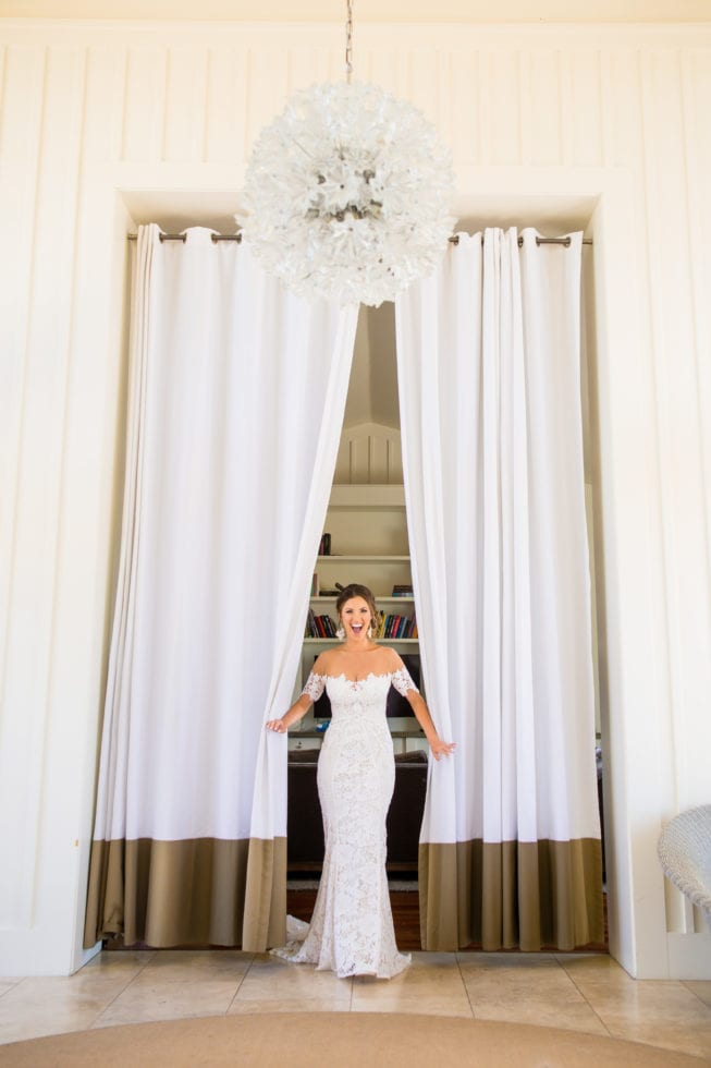 wedding photograph of bride showing off her dress