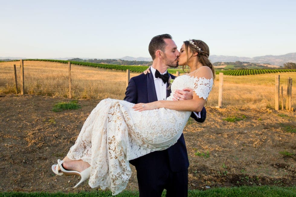 wedding photography of groom carrying bride at carneros resort