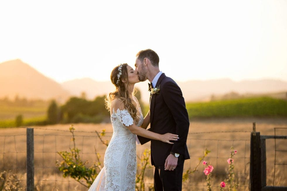 wedding day photography of bride and groom kissing at carneros resort