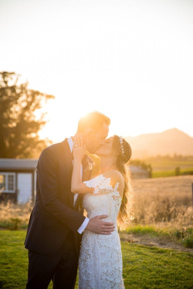 wedding photography of bride and groom kissing in the sunset at carneros resort