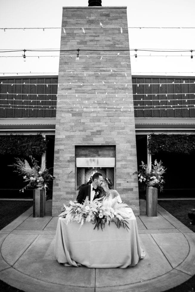 wedding photography of couple kissing at their reception at carneros resort