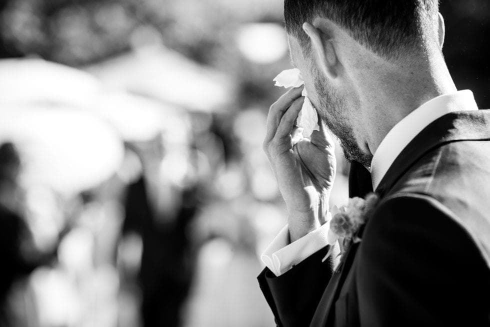 wedding photography of groom crying when he sees bride at carneros resort